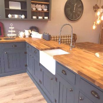 Modern farmhouse kitchen design. Dark blue lacquered cupboards and butcher shop ..., ...#blue